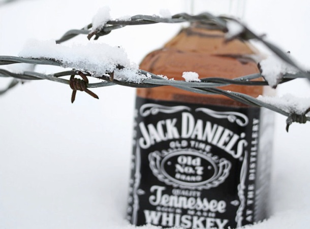jack_daniels_in_snow_by_sp333d1-d35swbv