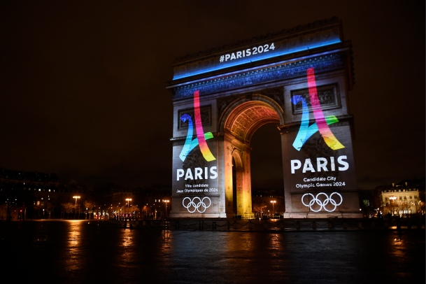 The campaign's official logo of the Paris bid to host the 2024 Olympic Games is seen on the Arc de Triomphe in Paris on February 9, 2016. AFP PHOTO / LIONEL BONAVENTURE / AFP / LIONEL BONAVENTURE