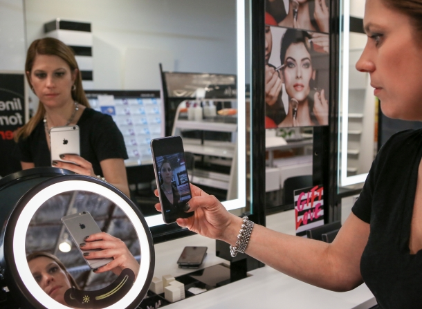 Johnna Marcus, senior director for Sephora Innovation Lab, demonstrates the Sephora's Pocket Contour Class technology which which launches on Thursday, March 5, 2015.